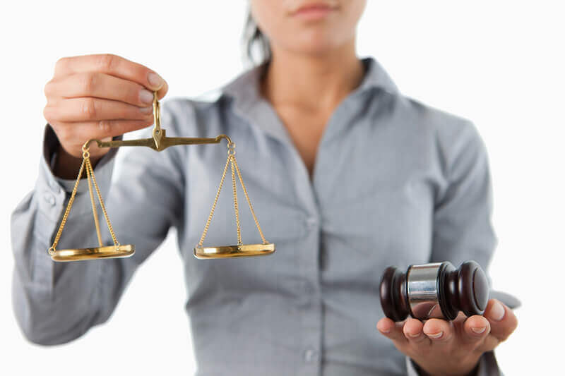 lawyer holding balance scale and gavel