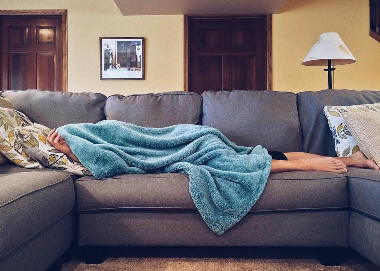 sleeping on couch with blanket