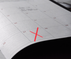 calendar with red x on the 27th