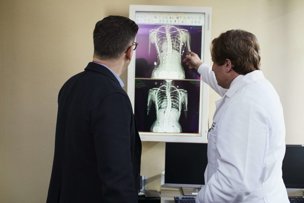 lawyer communicating with doctor over patient mri