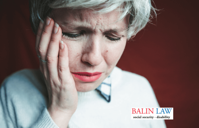 middle age woman in pain holding jaw from trigeminal neuralgia